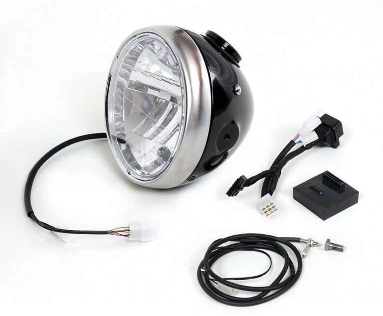 Classic headlight with integrated speedometer